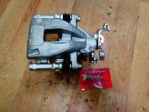 Суппорт тормозной задний правый Geely Emgrand 1064001723